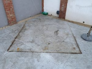Before cleaning the patio is heavily marked and rust stained.