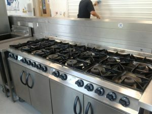 Pictures of clean kitchen equipment at a local school.