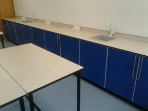 Clean desks and bench areas of a school science lab in Hampshire