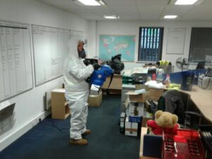 Photos showing our team fogging workplaces