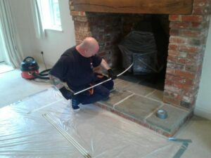 Photo of our operative sweeping a chimney