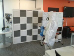 Photos showing the deep clean team carrying out fogging to an office premises